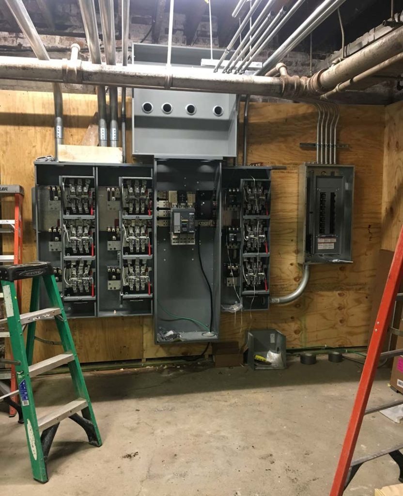 Clean, new electrical panels prior to their door installation