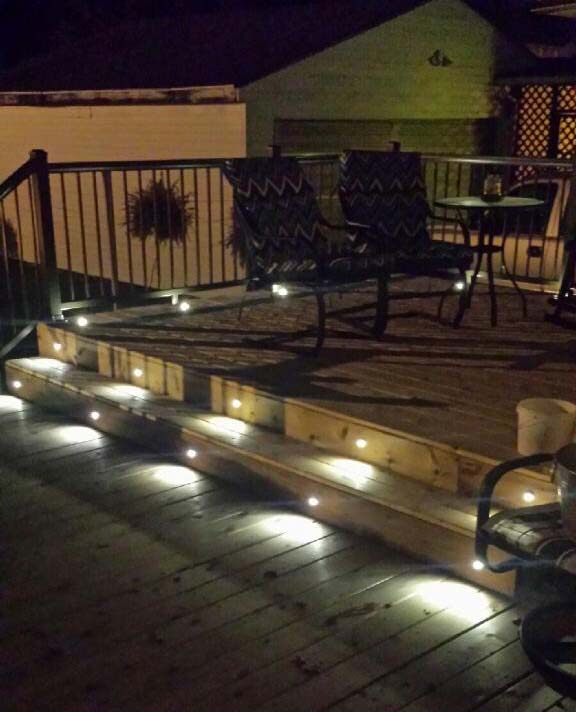 Wooden deck with custom lights on stairs