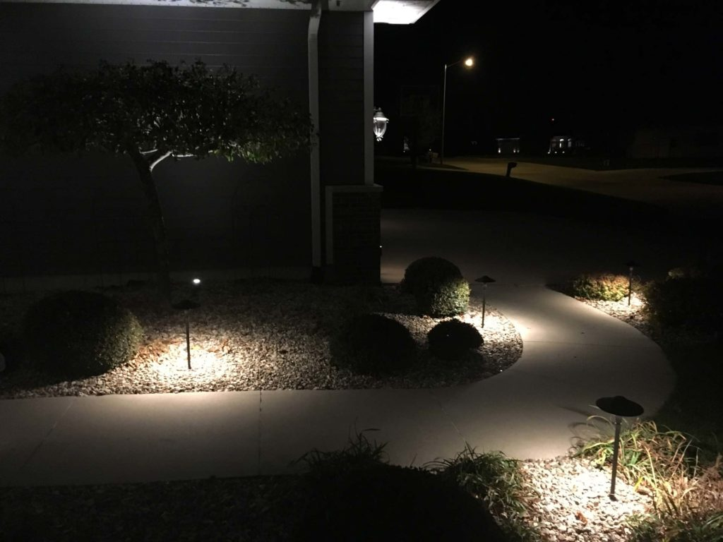 Residential front walkway at night