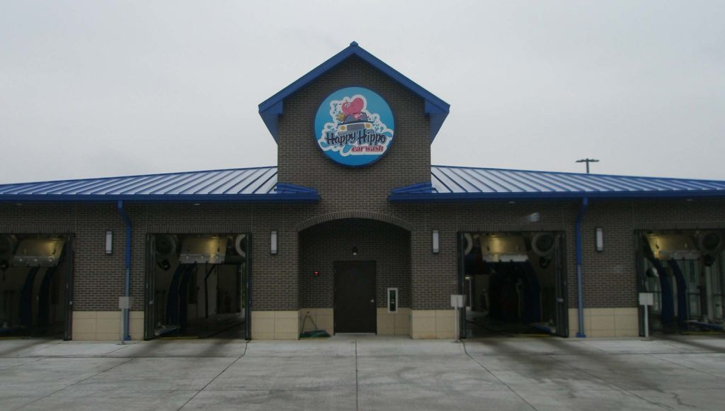 External shot of the Happy Hippo Car Wash in Cedar Falls, Iowa