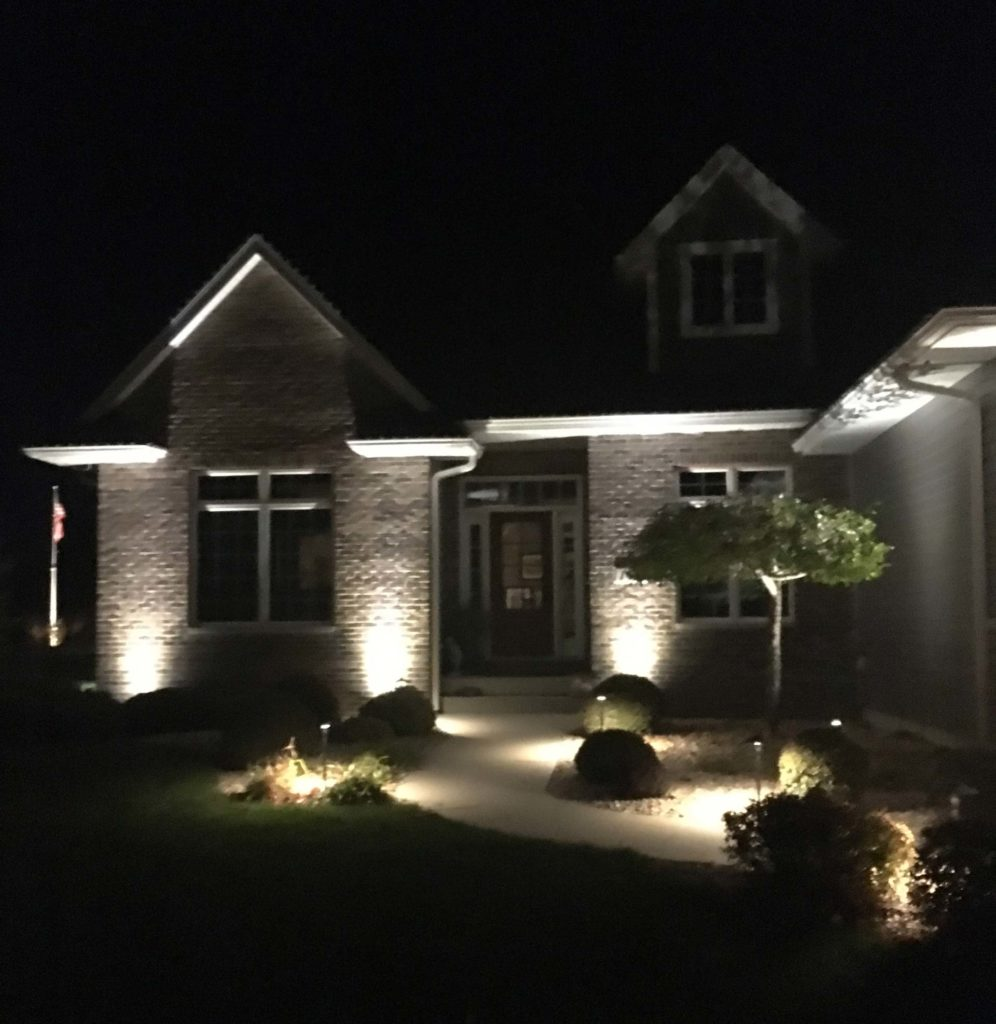 Residential front of house with lighting shown on house