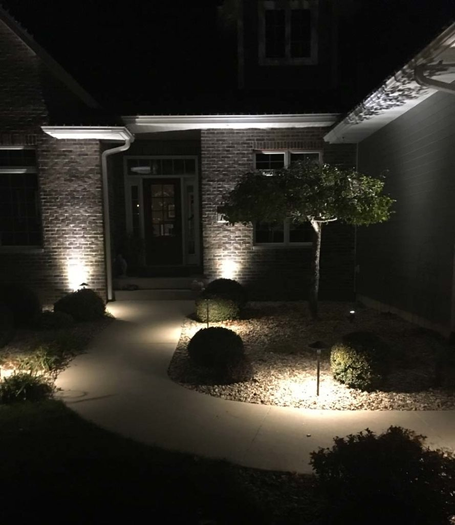 Residential front door walkway at night