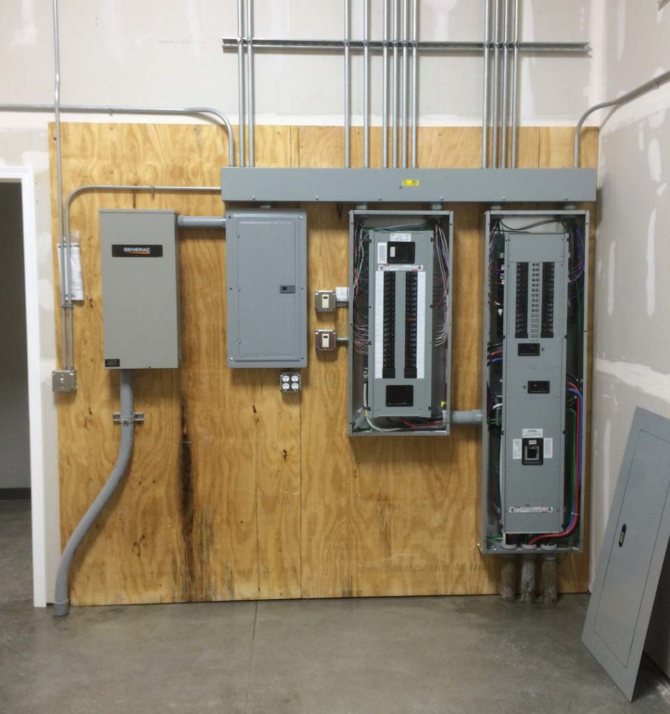 Clean, new electrical panels in a new commercial building service project