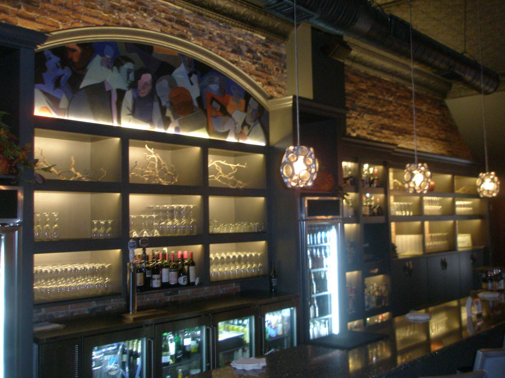 Wide Angle of custom lighting for the shelving at the Olympus Bar