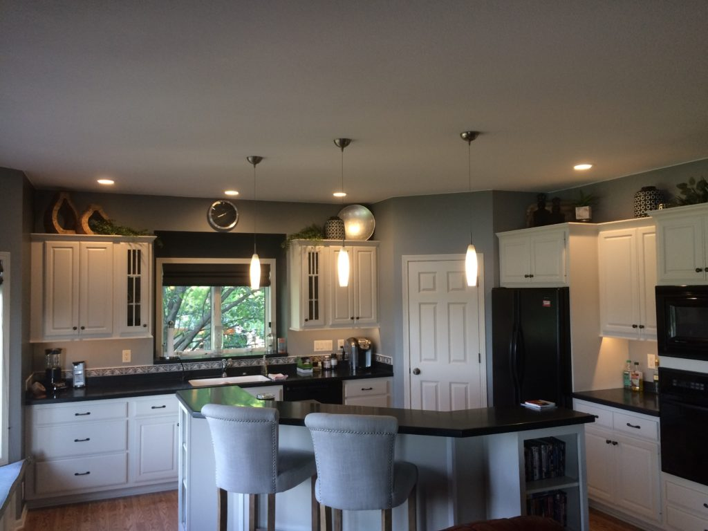 Custom lighting for a kitchen, featuring hanging lights above an island