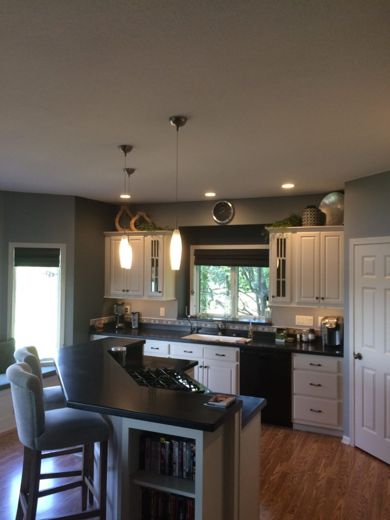 Custom Kitchen Project with hanging lights over an island