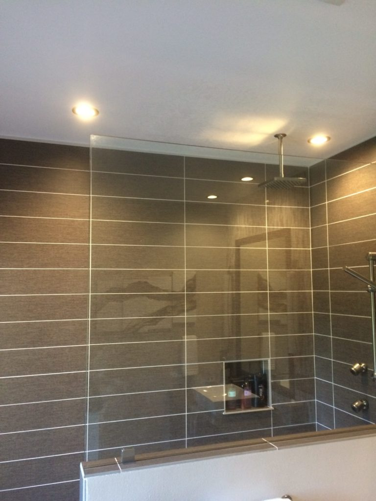 Custom lighting for a brand new shower from an external viewpoint